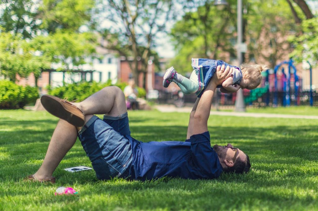father and child on beautiful lawn Paradise Landscaping and Tree Removal